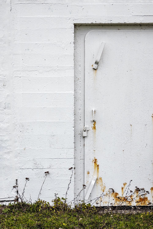 white wooden door with white door lever