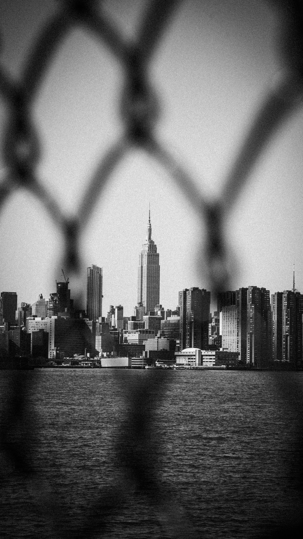grayscale photo of city skyline during daytime