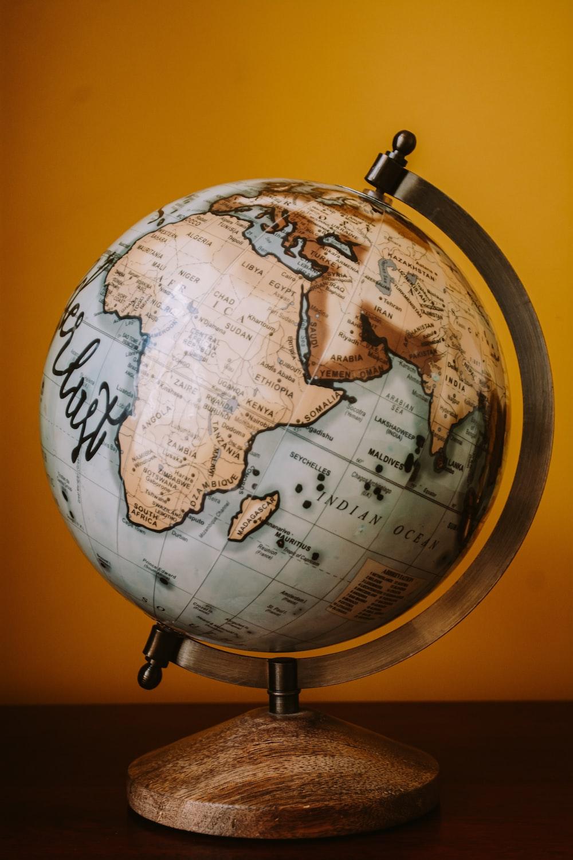 brown and white desk globe