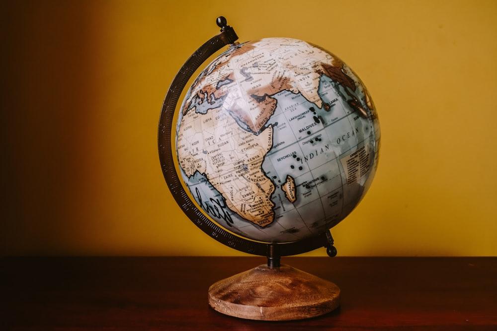 white and brown desk globe