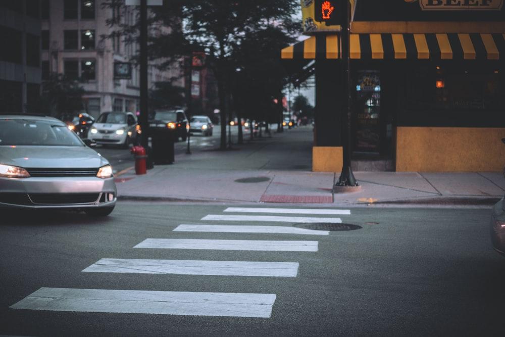 white car on pedestrian lane during daytime