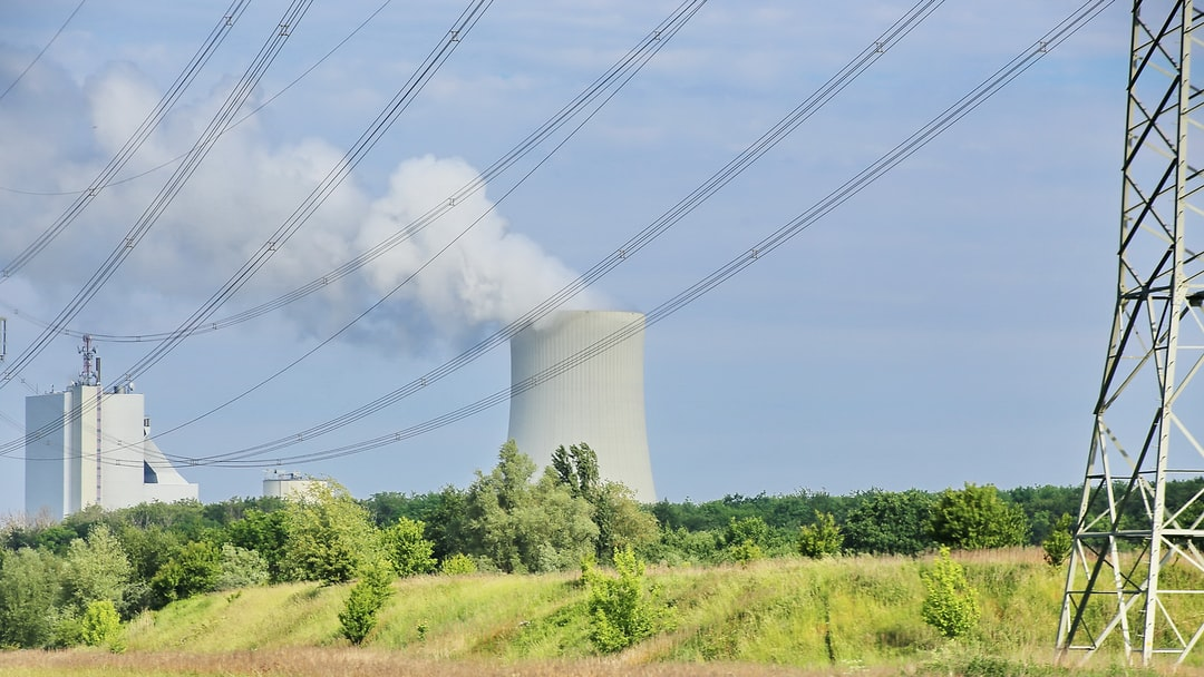 The past of fossil-based energy supply: Overland electicity lines with Rostock Power Station in the background which is a bituminous coal-fired combined heat and power plant, located in Rostock, Germany.