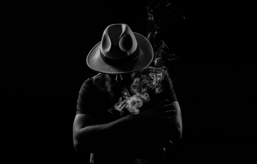 grayscale photo of person wearing cowboy hat