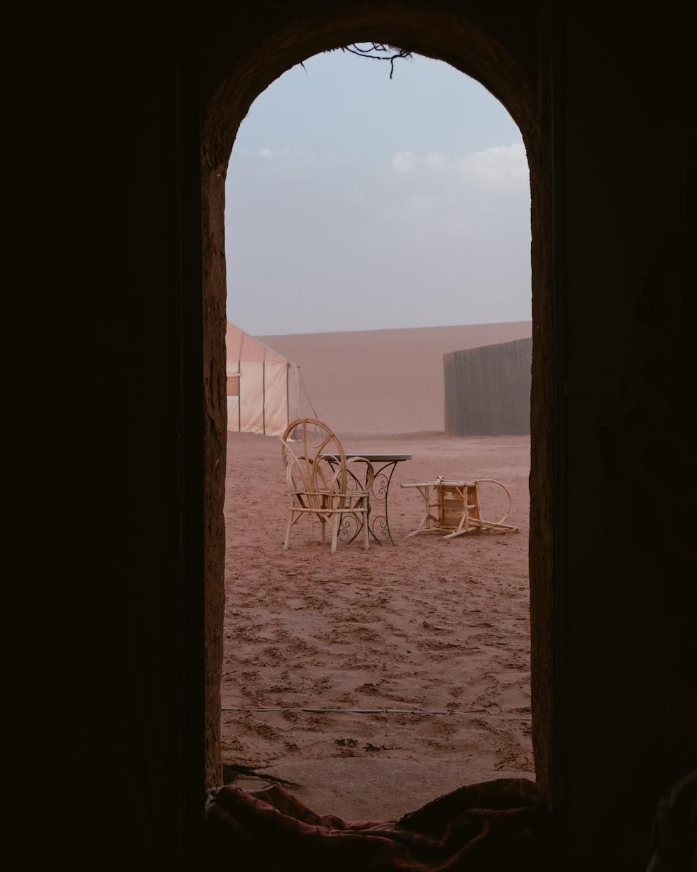 people riding camel on desert during daytime