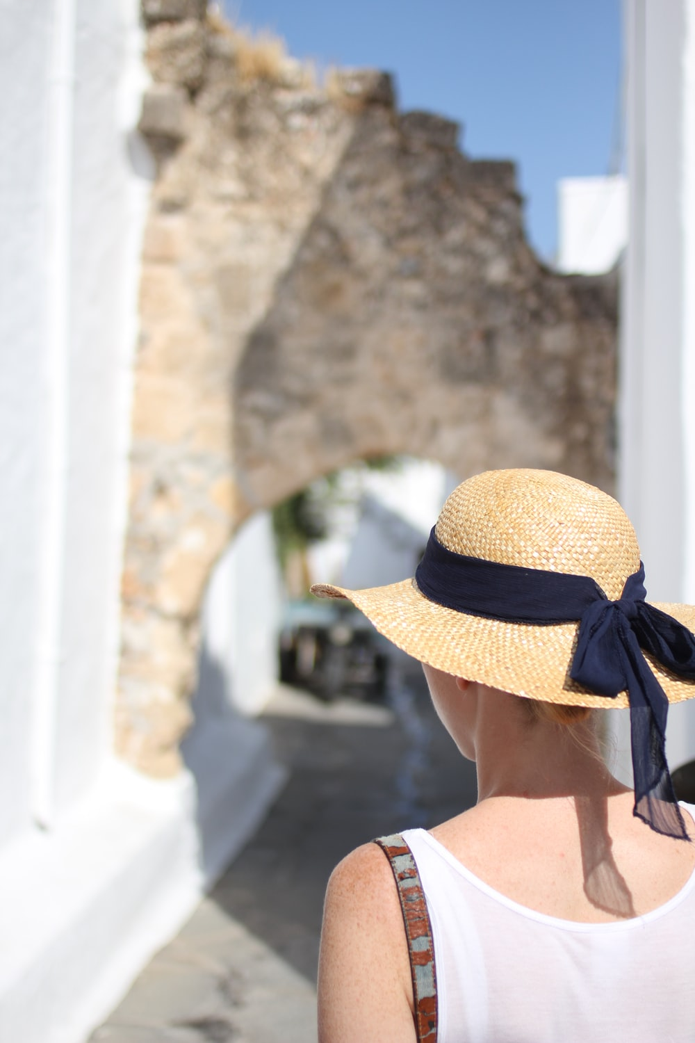 woman in blue and white striped sun hat