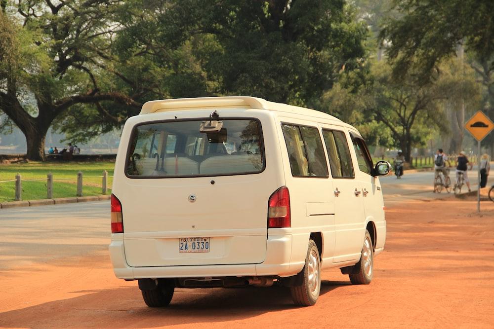 white volkswagen t-2 on road