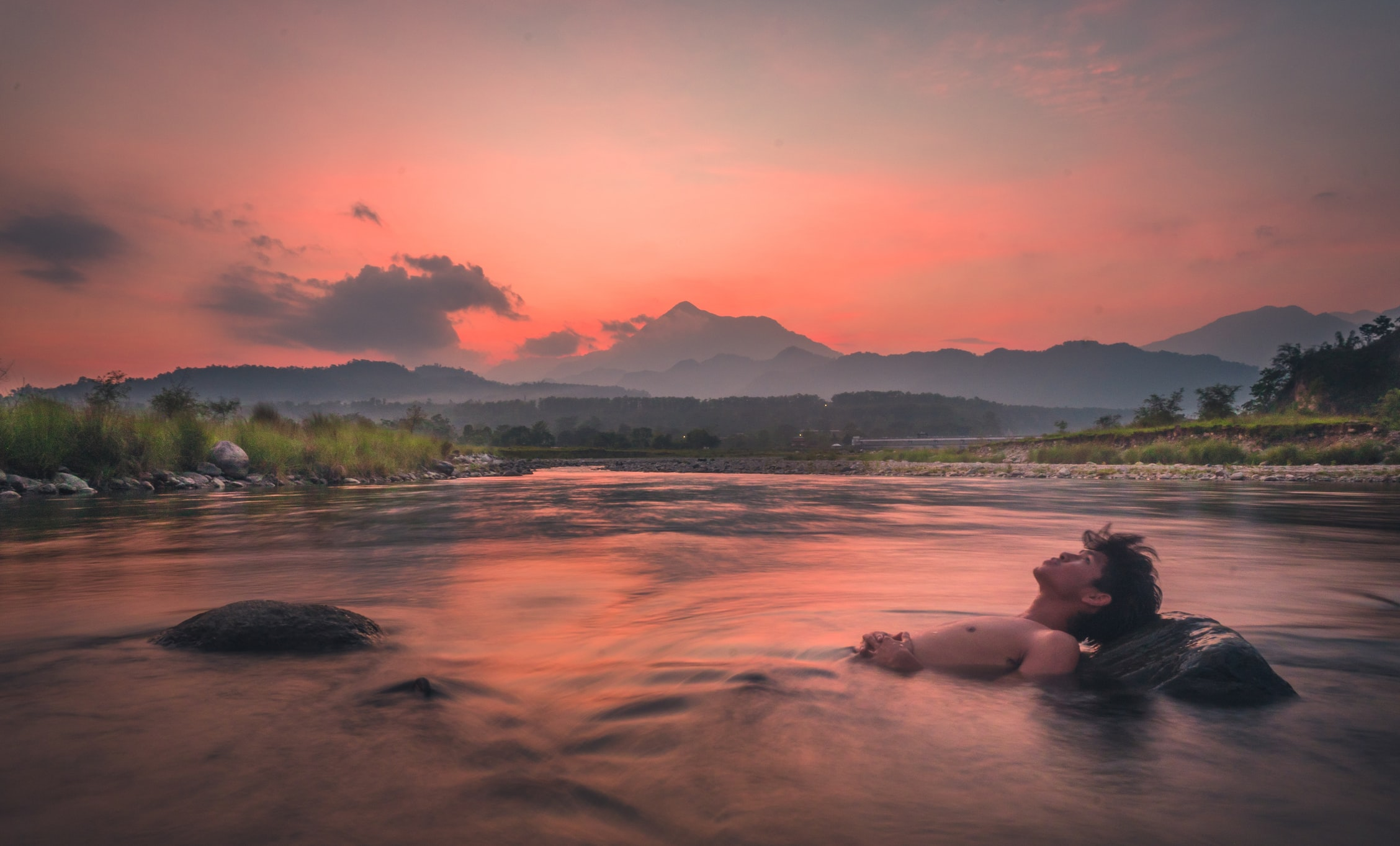 A man rests in a river in Assam, one of the seven sister states