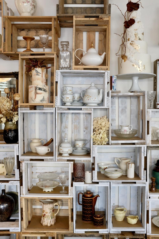 white ceramic tea set on brown wooden shelf