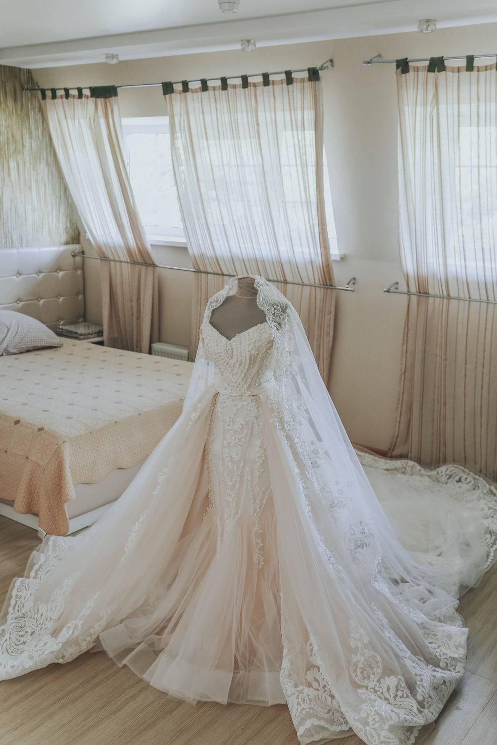 white wedding gown on bed