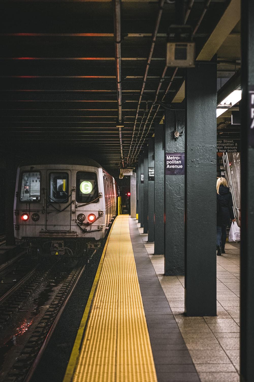 people walking on train station during daytime