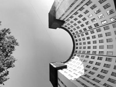 grayscale photo of concrete building constructivism zoom background