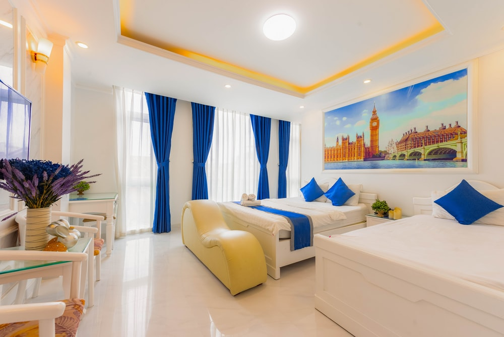 white bed near white wooden bed frame