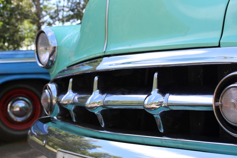 green and silver vintage car