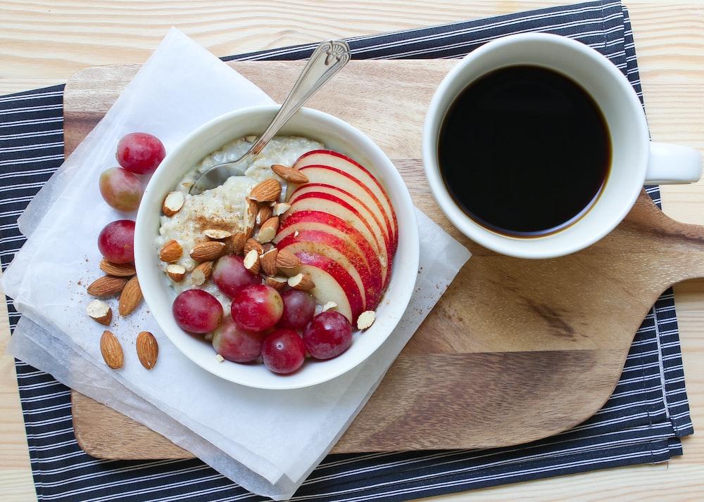 red fruit on white ceramic bowl