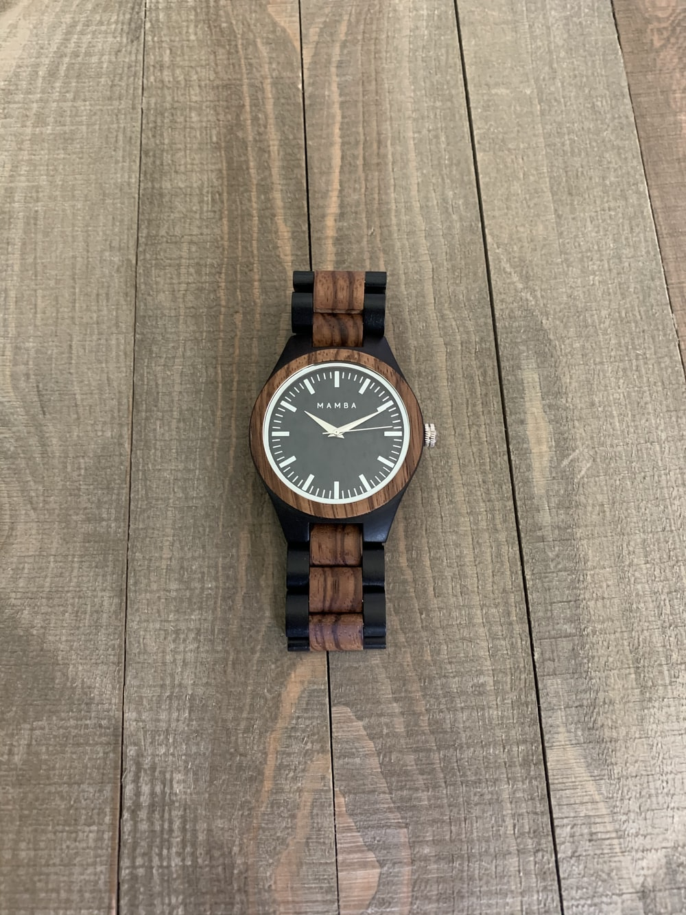 brown and white analog watch at 10 10