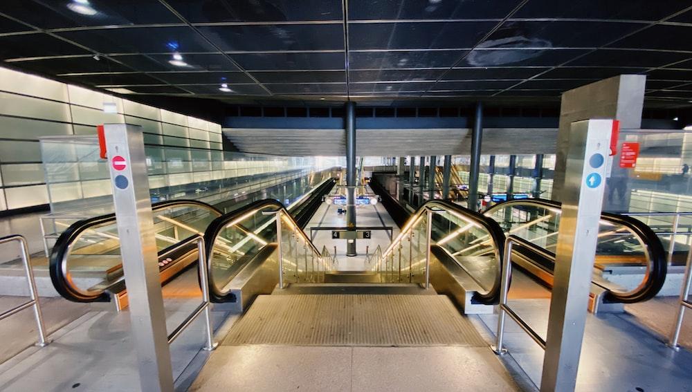 gray and black escalator inside building