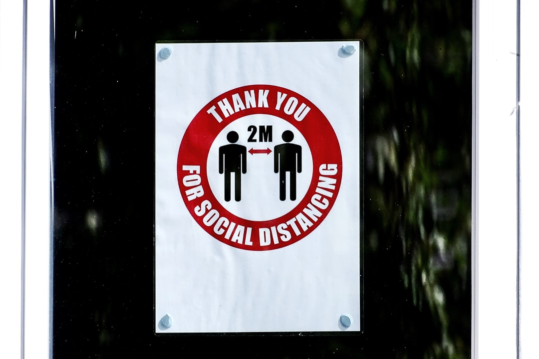 A sign in a school window reminding pupils to keep their Social Distance.  I like the  Message of Thank You.