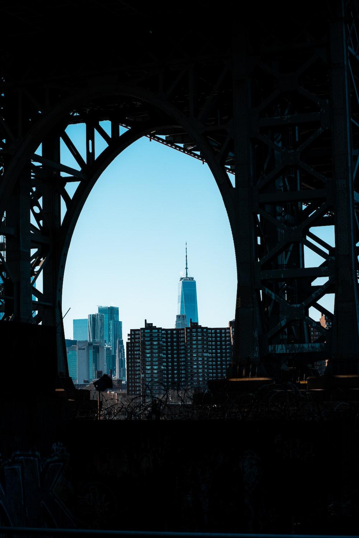 white bridge over city skyline during daytime