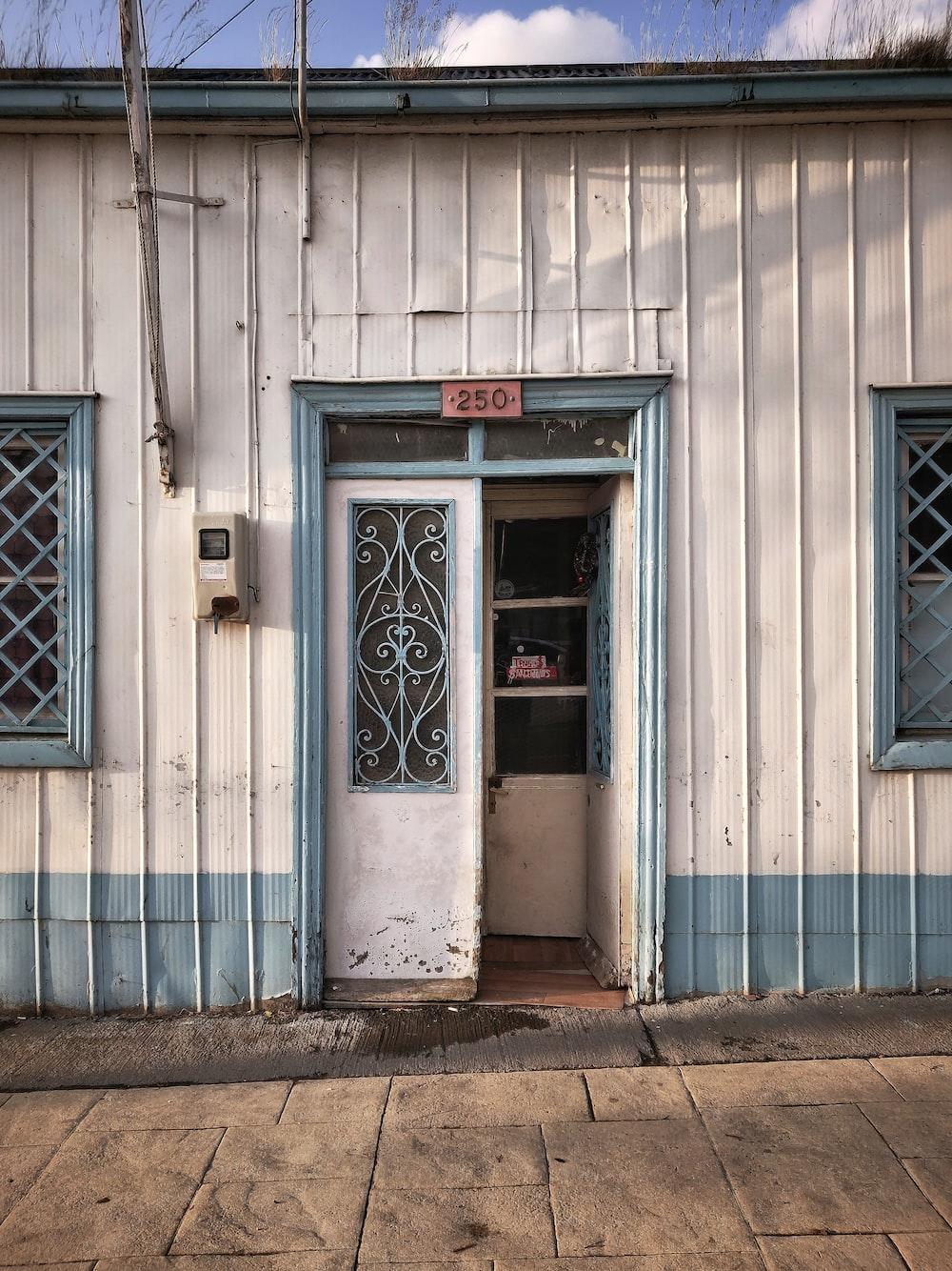 white wooden door with black steel door