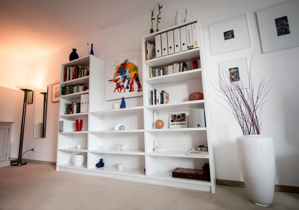 white wooden shelf with books