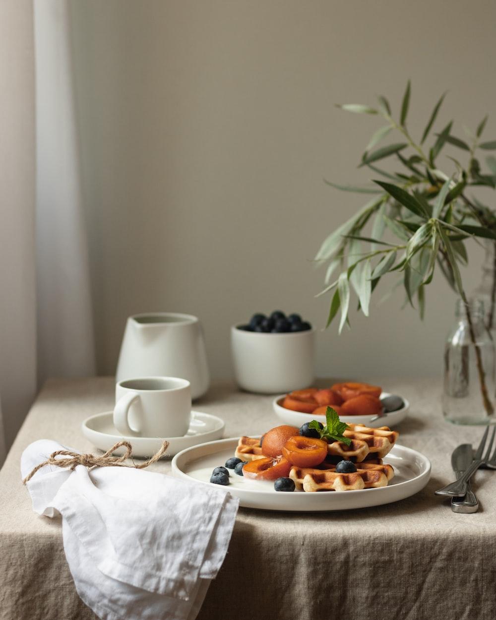 white ceramic mug on white ceramic plate
