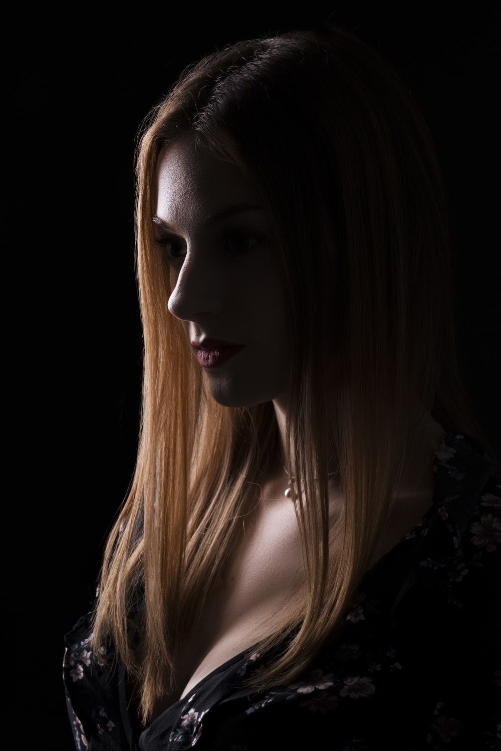 woman in black shirt with blonde hair