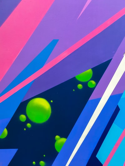 pink green and blue abstract painting