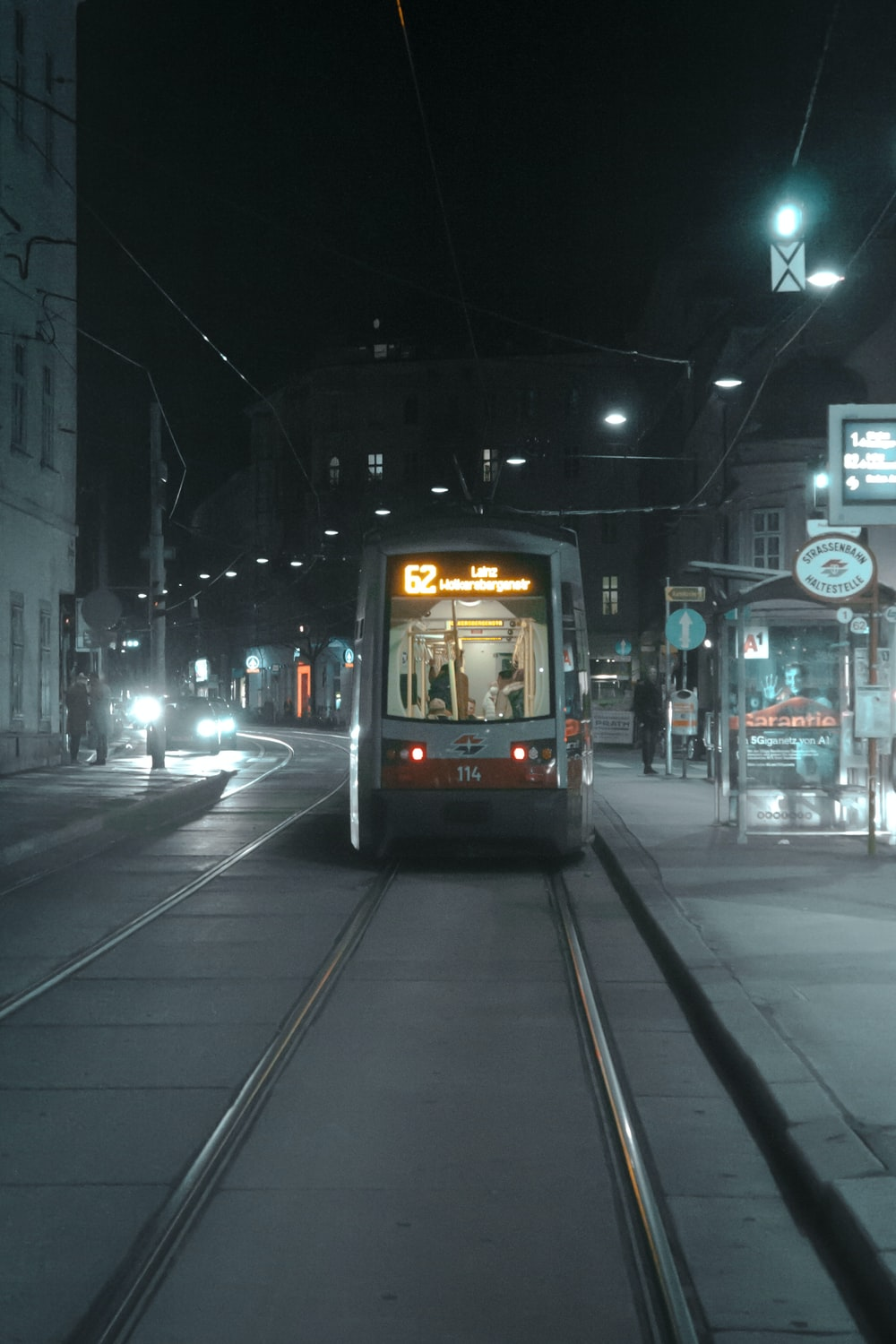 black and white tram on road during night time