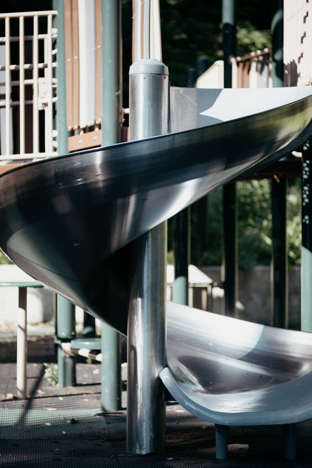 stainless steel railings near green trees during daytime