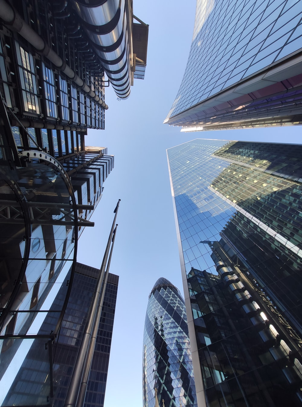 low angle photography of high rise buildings