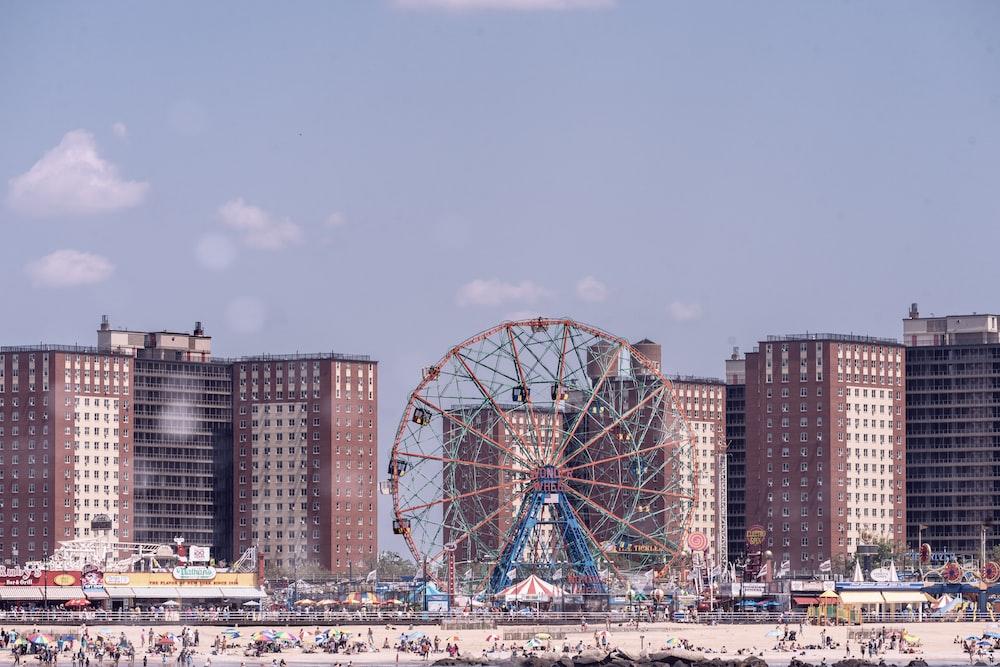 ferris wheel near city buildings during daytime