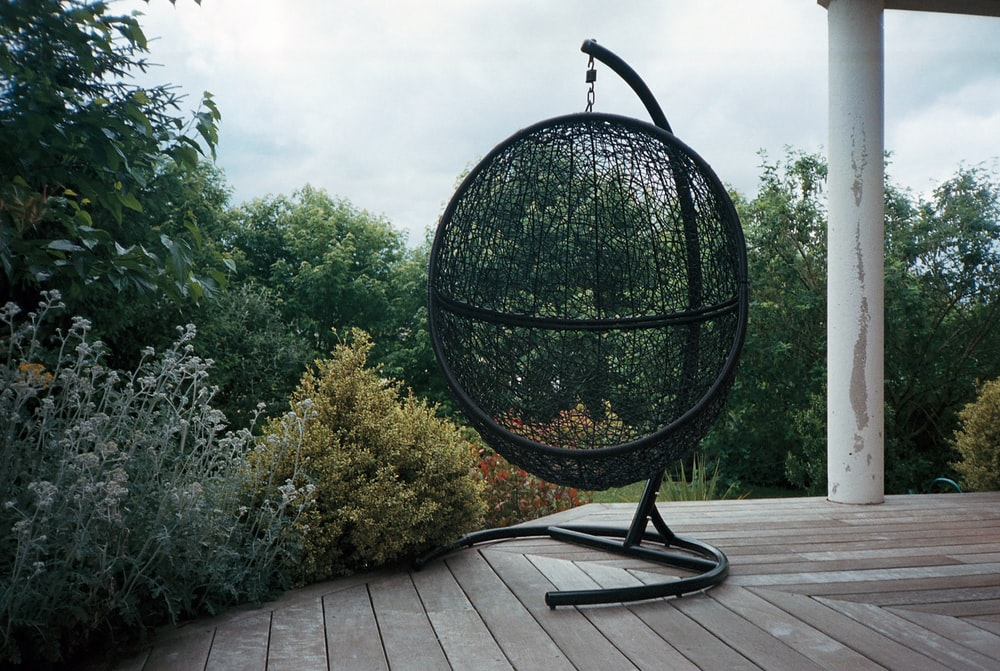 black round metal table near green trees during daytime