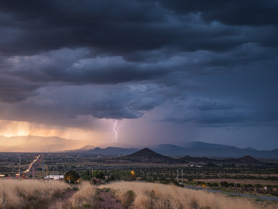 Lightning striking the Santa Fe mountains during monsoon season in New Mexico.