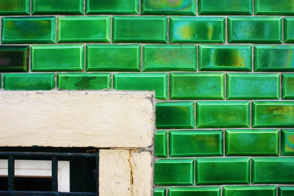 green and white concrete wall