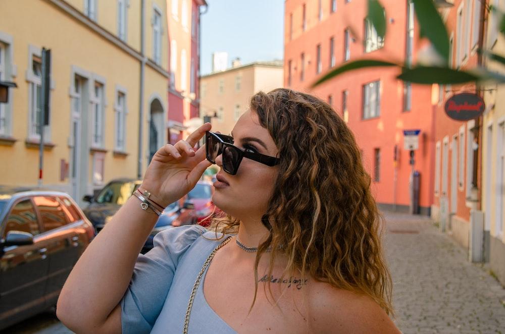 woman in white tank top wearing black sunglasses