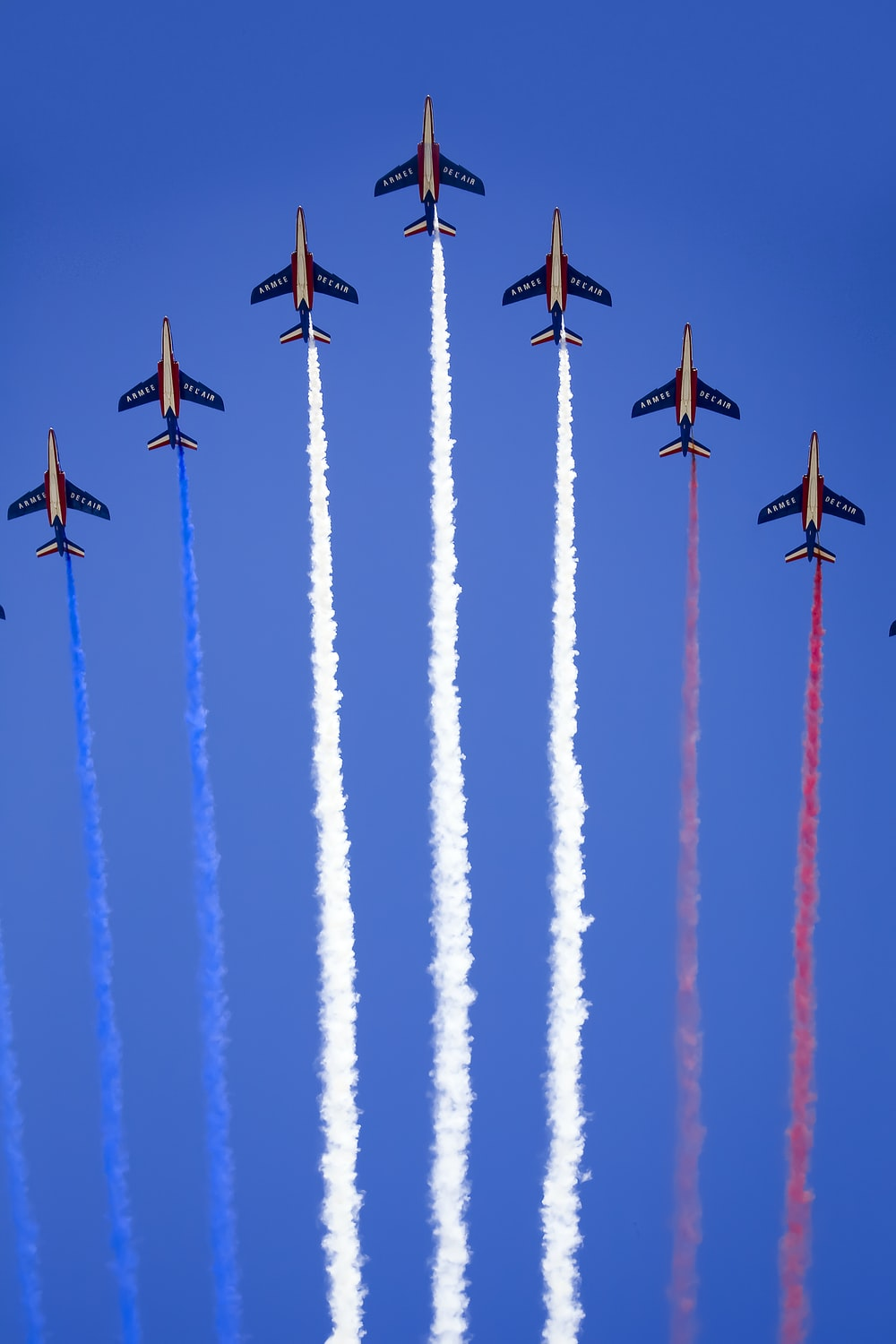 eight fighter planes in mid air