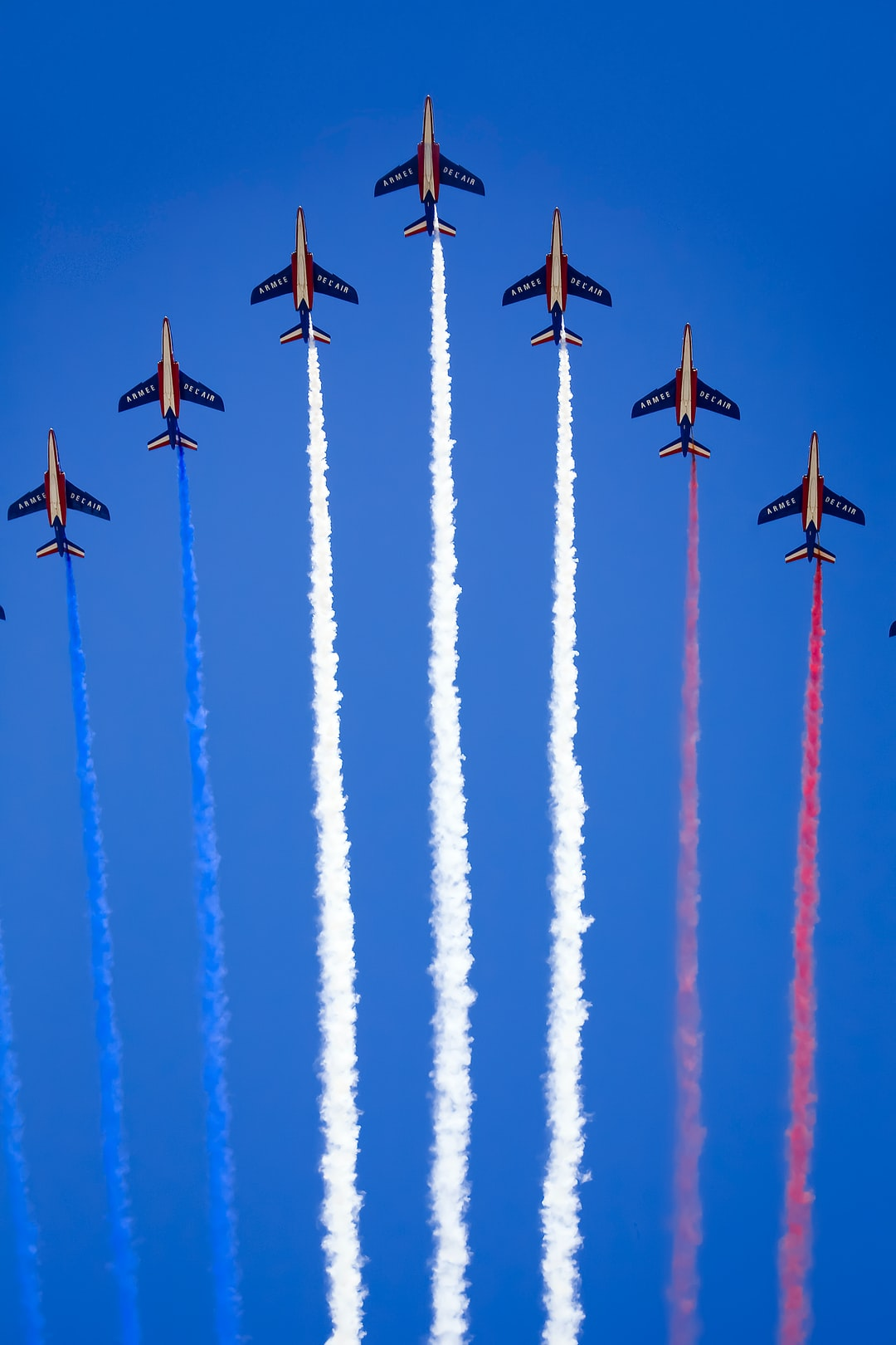 On July 14, Mirage fighter planes of the French Air Force fly over the huge crowds lining the Champs Elysees, in celebration of French independence.