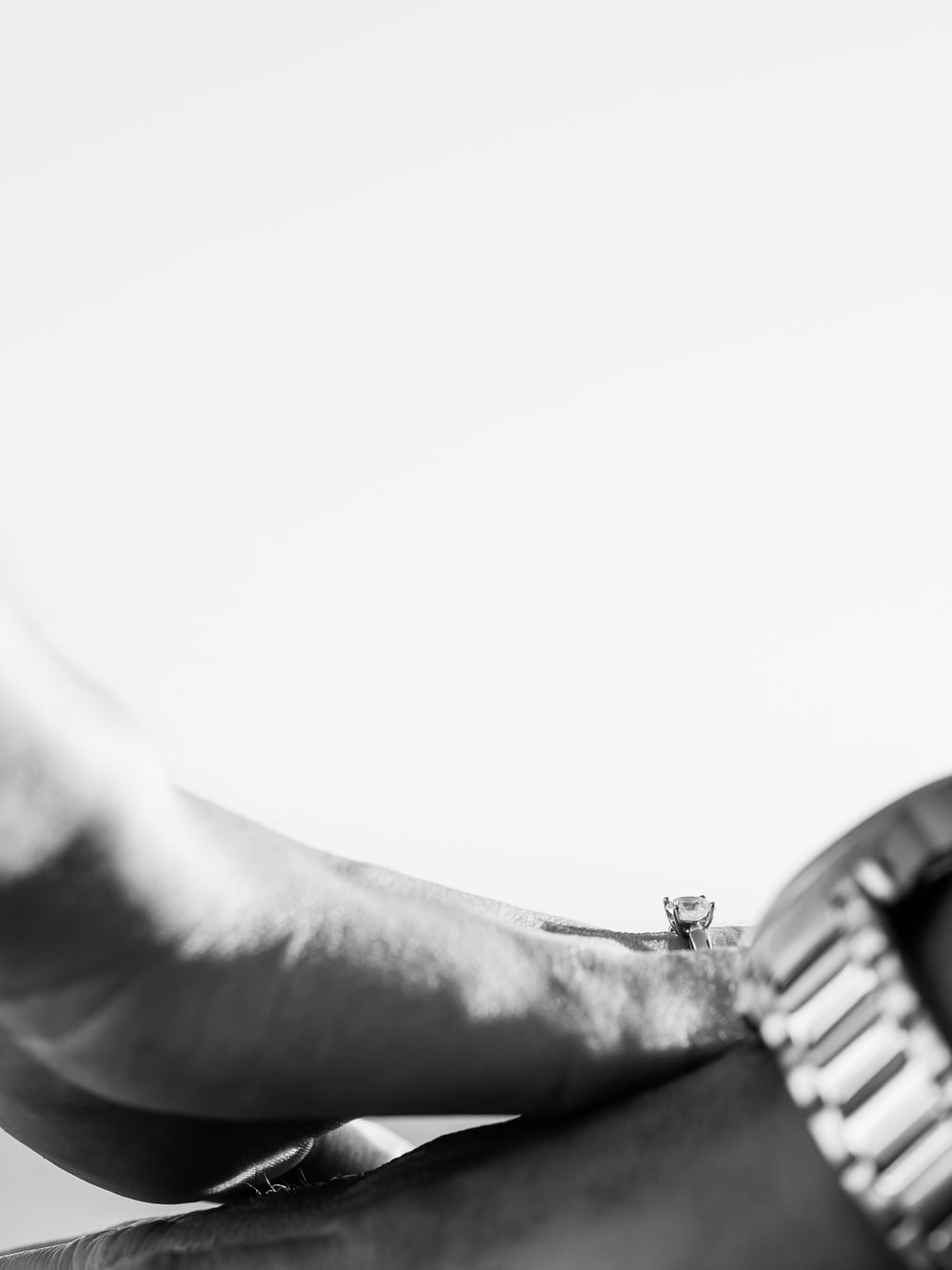 grayscale photo of person wearing watch