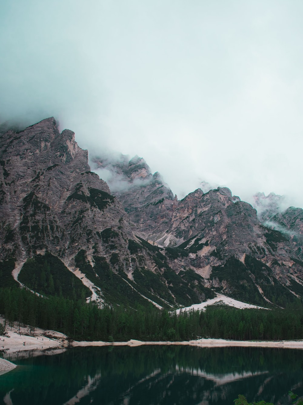 gray rocky mountain under white sky during daytime