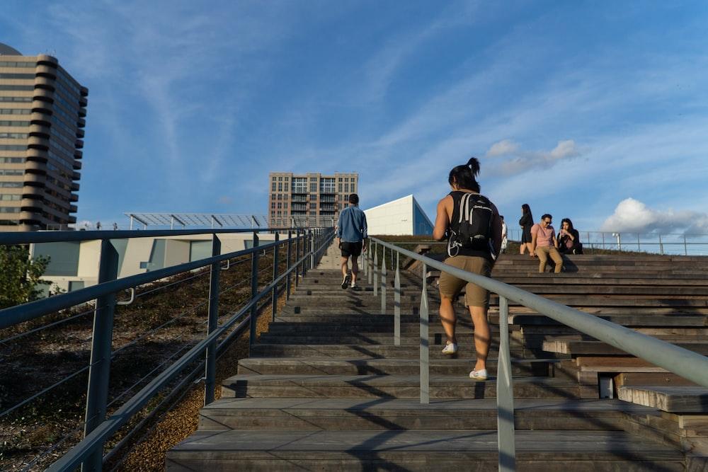 people walking on the bridge during daytime