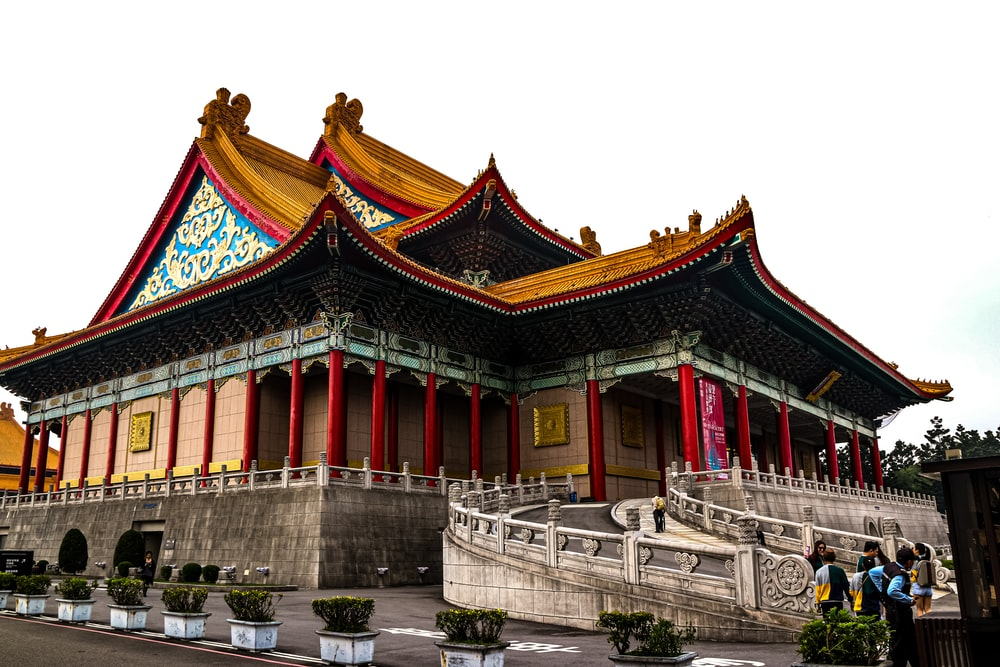 red and blue temple during daytime