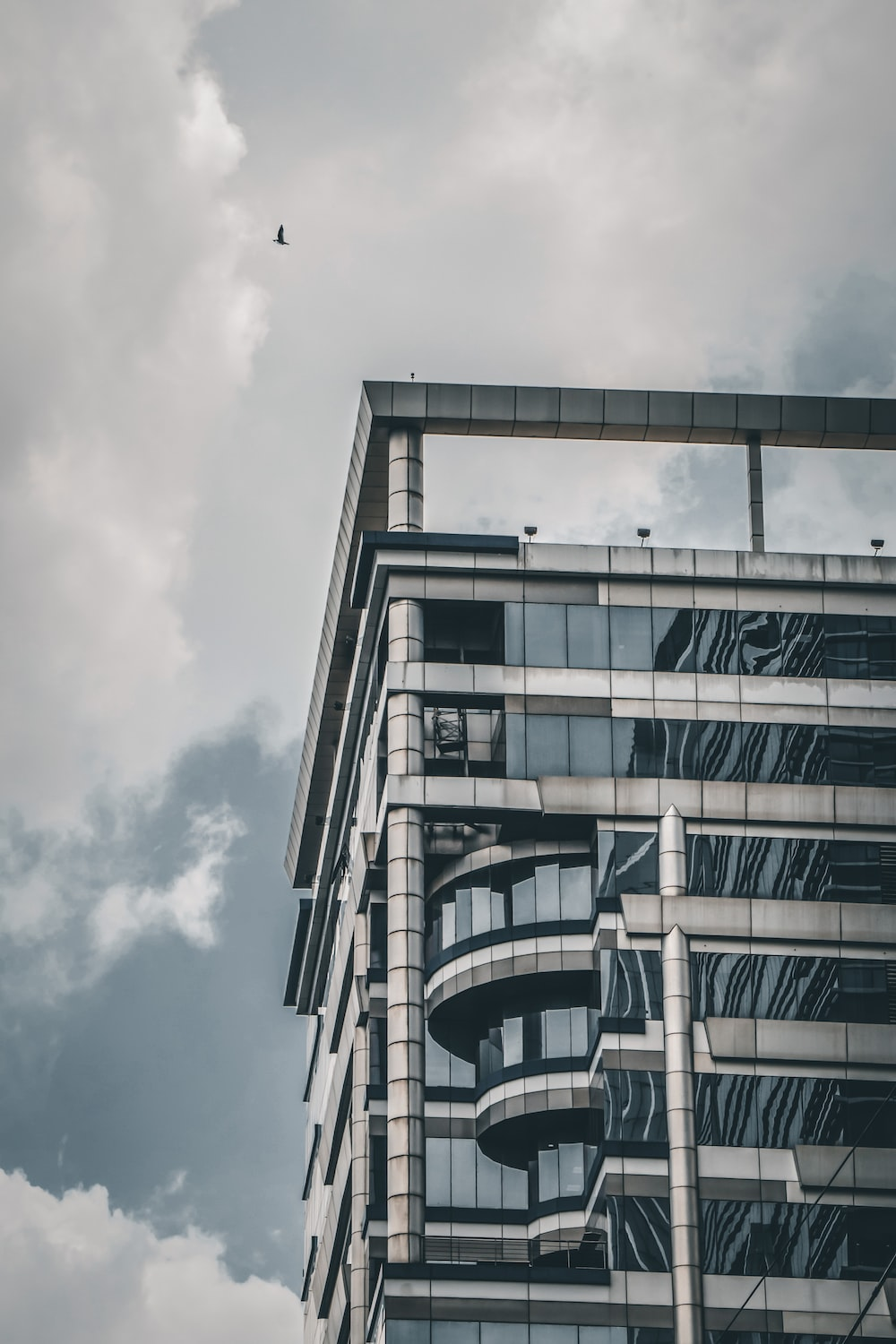 white concrete building under cloudy sky during daytime