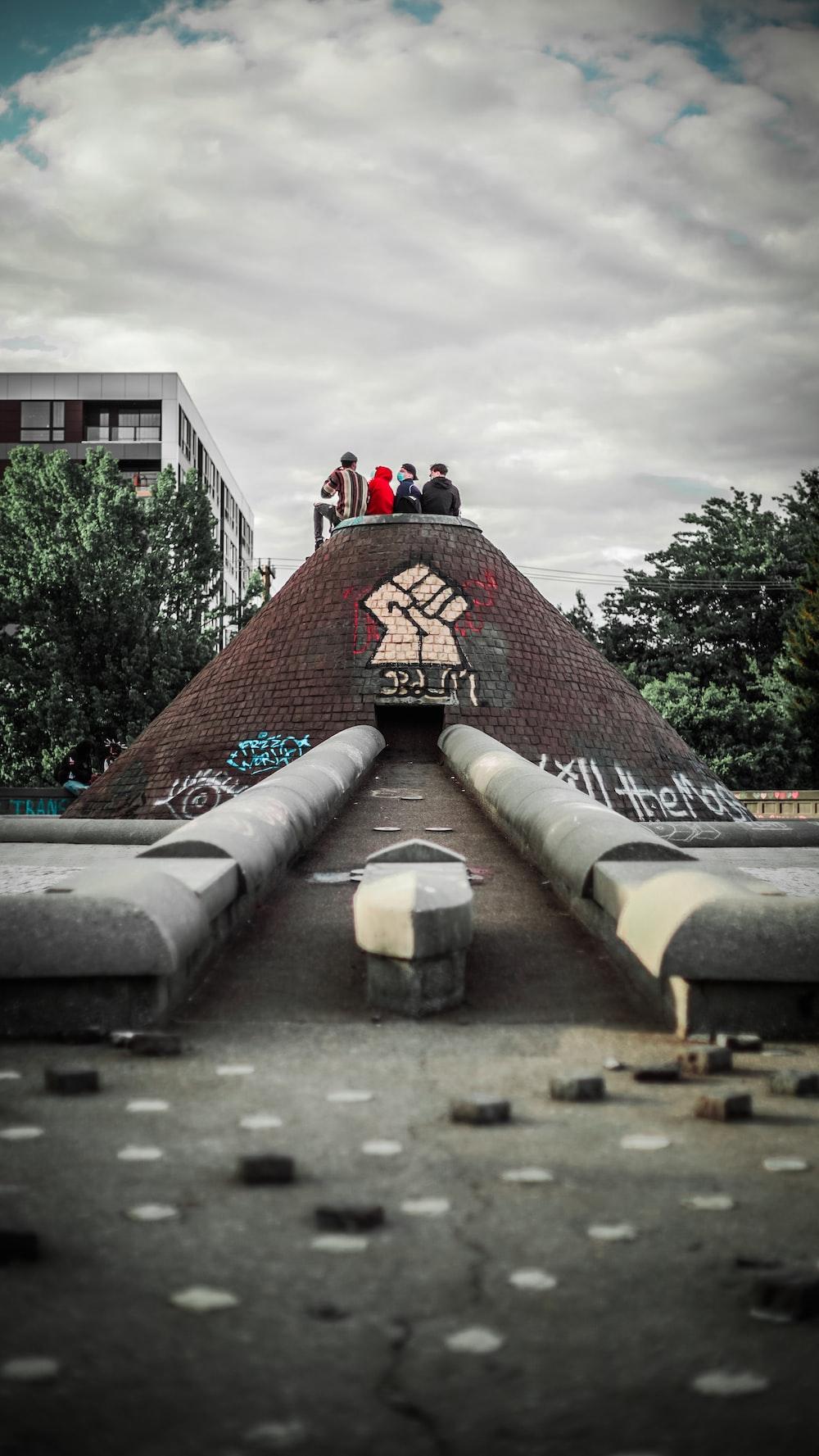 people walking on brown concrete stairs during daytime