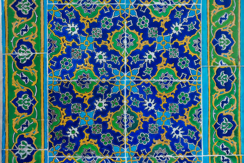 yellow blue and white floral textile