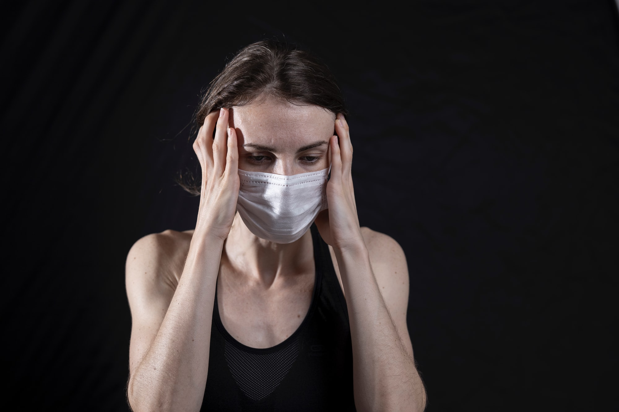 young woman and coronavirus mask