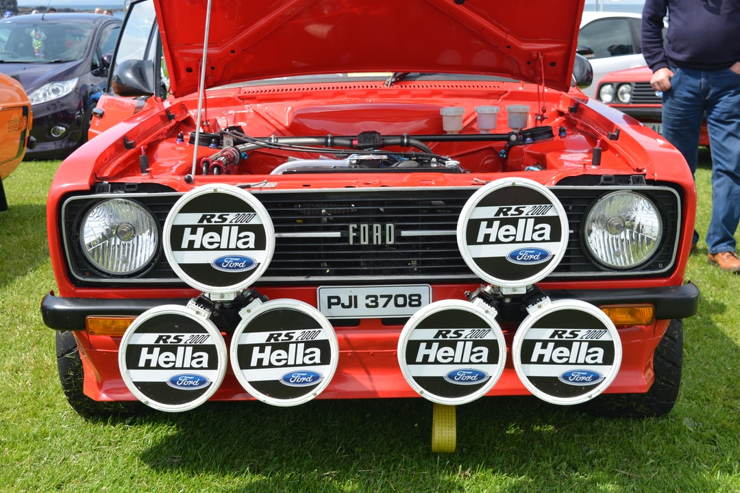 A red Ford Escort RS Mark 2 at a classic car show