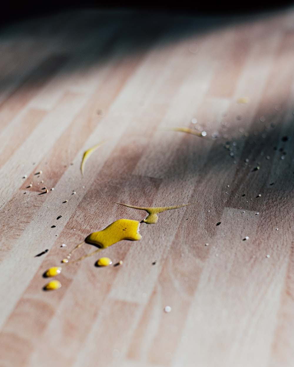 yellow butterfly on brown wooden table