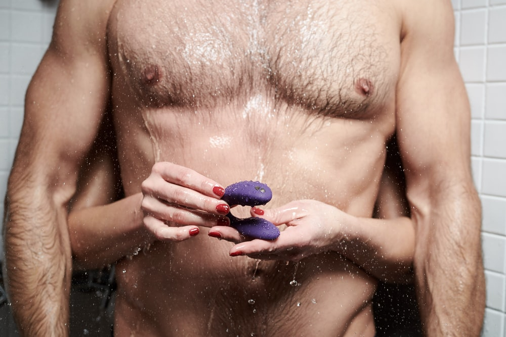 topless woman with blue nail polish