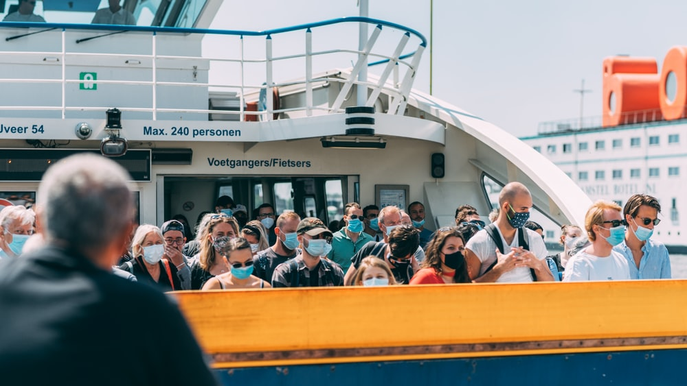 people sitting on yellow and white boat during daytime
