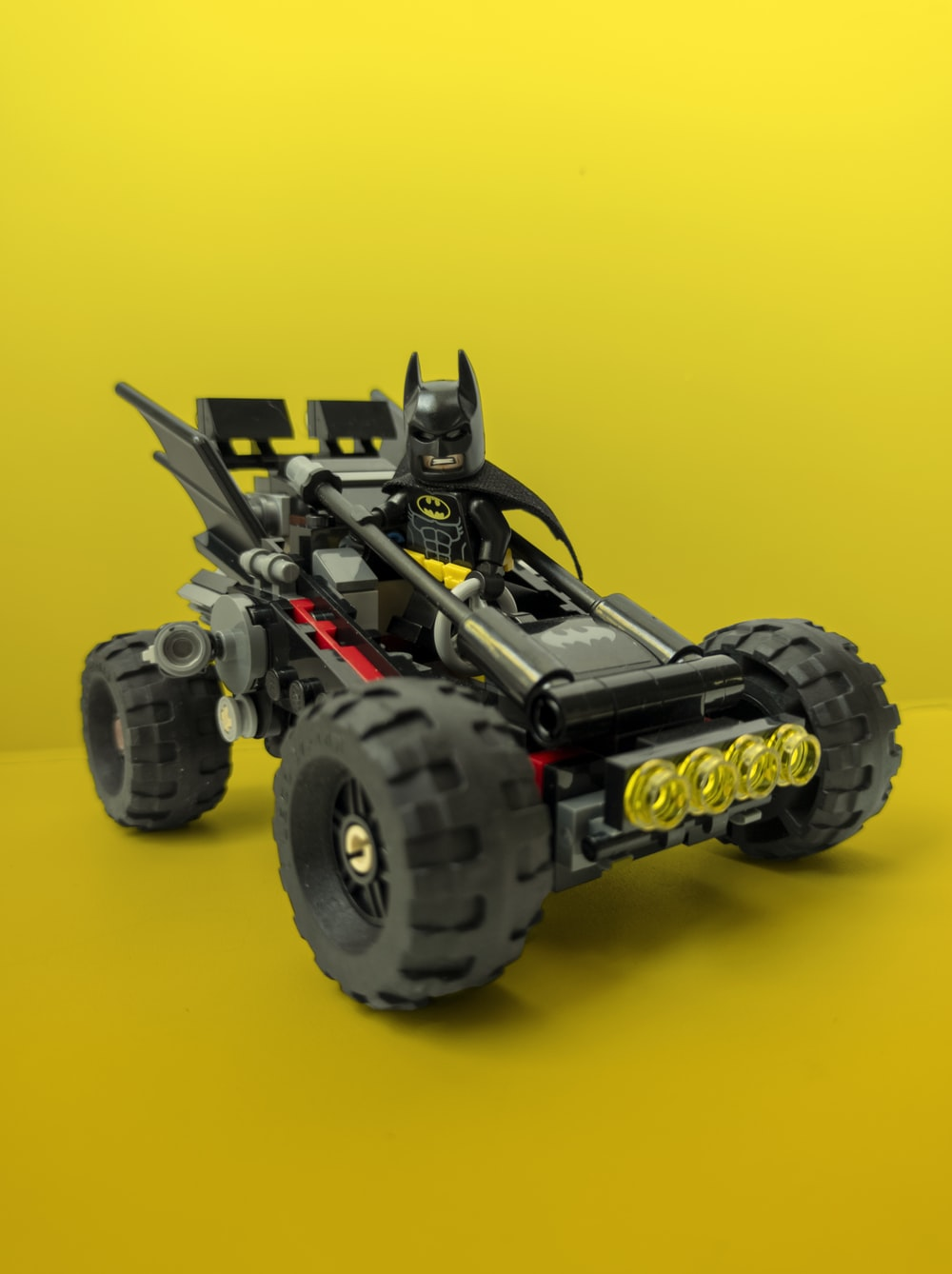 black and yellow monster truck toy